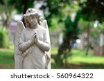 angel statue in cemetery | Shutterstock . vector #560964322