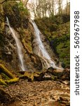grey mares tail waterfall or... | Shutterstock . vector #560967988