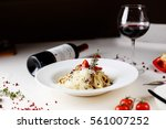 italian pasta with wine | Shutterstock . vector #561007252