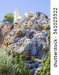 cyprus monastery on rock | Shutterstock . vector #561025522