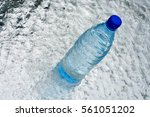 a bottle of pure water on water ... | Shutterstock . vector #561051202