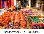 Small photo of pots of terra cotta and stoneware for the traditional delicious dishes Tajine and Couscous with partially colorful decorative ornamental painting on a market in the Medina of Fes in Morocco in Africa