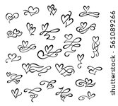Set of hand drawn calligraphic design elements with hearts for Valentine's day. Flourish swirl ornate decoration for wedding cards, in invitations, save the date cards, postcard, menu, romantic style