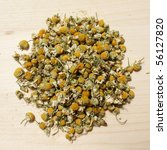Pile of dried chamomile flowers - stock photo