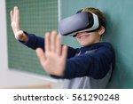 little boy smiling wearing... | Shutterstock . vector #561290248