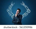 businessman with robotic arms... | Shutterstock . vector #561350986