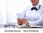 woman in office using mobile... | Shutterstock . vector #561353836