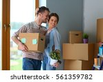happy young couple unpacking or ... | Shutterstock . vector #561359782