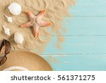 sand and shells on the wooden... | Shutterstock . vector #561371275
