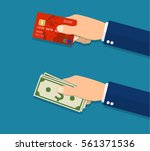 hands holding credit card and... | Shutterstock .eps vector #561371536