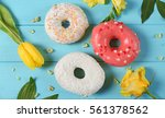 delicious colourful donuts and... | Shutterstock . vector #561378562