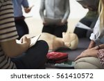 cpr first aid training concept | Shutterstock . vector #561410572