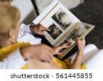senior couple look photo album | Shutterstock . vector #561445855
