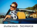beautiful pin up woman sitting... | Shutterstock . vector #561446416