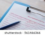 health insurance claim form... | Shutterstock . vector #561466366