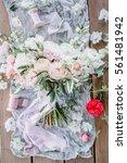 beauty wedding bouquet of roses | Shutterstock . vector #561481942