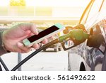man use mobile phone  employee... | Shutterstock . vector #561492622