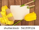 bouquet of tulips and gift box  | Shutterstock . vector #561559126