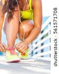 running shoes   woman tying... | Shutterstock . vector #561571708