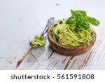 raw zucchini pasta on white... | Shutterstock . vector #561591808