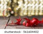 heart shape ribbon in front of... | Shutterstock . vector #561604402