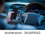 man driver using smart phone in ... | Shutterstock . vector #561609262