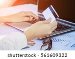 woman's hands holding a credit... | Shutterstock . vector #561609322