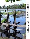 Small photo of SAN PABLO CITY, LAGUNA, PHILIPPINES - JANUARY 21, 2017: unkempt, weather damaged lake foot bridge environmental issues that destroy lake