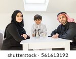 happy arabic family at dining... | Shutterstock . vector #561613192