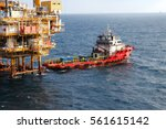 supply boat transfer cargo to... | Shutterstock . vector #561615142