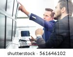 businessmen trading stocks.... | Shutterstock . vector #561646102
