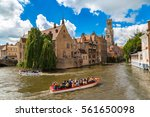 canal in bruges and famous... | Shutterstock . vector #561650098