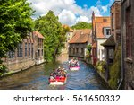tourist boat on canal in bruges ... | Shutterstock . vector #561650332