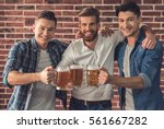 attractive guys are clinking... | Shutterstock . vector #561667282