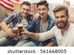 attractive guys are clinking... | Shutterstock . vector #561668005