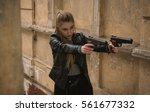 Small photo of Powerful Woman Holding Gun Action Movie Style - Portrait of a girl in a heroine cosplay accessorized costume