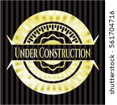 under construction gold badge... | Shutterstock .eps vector #561704716