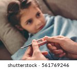 sick little girl covered in... | Shutterstock . vector #561769246