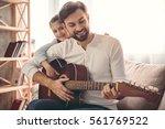 cute little girl and her... | Shutterstock . vector #561769522