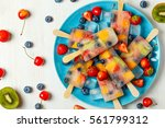 homemade popsicles with berries ... | Shutterstock . vector #561799312