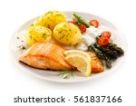 grilled salmon boiled potatoes... | Shutterstock . vector #561837166