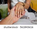 man holding his girlfriend's... | Shutterstock . vector #561843616