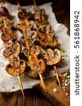 skewers with mushrooms | Shutterstock . vector #561868942