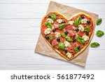heart shaped pizza delicious... | Shutterstock . vector #561877492