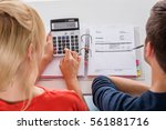 close up of couple calculating... | Shutterstock . vector #561881716