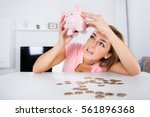 young unhappy woman emptying... | Shutterstock . vector #561896368