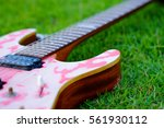 pink guitar on lawn background  ... | Shutterstock . vector #561930112