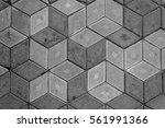 gray plates of street pavement...   Shutterstock . vector #561991366