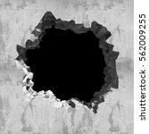 explosion hole in concrete...   Shutterstock . vector #562009255