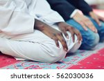 two religious muslim man... | Shutterstock . vector #562030036